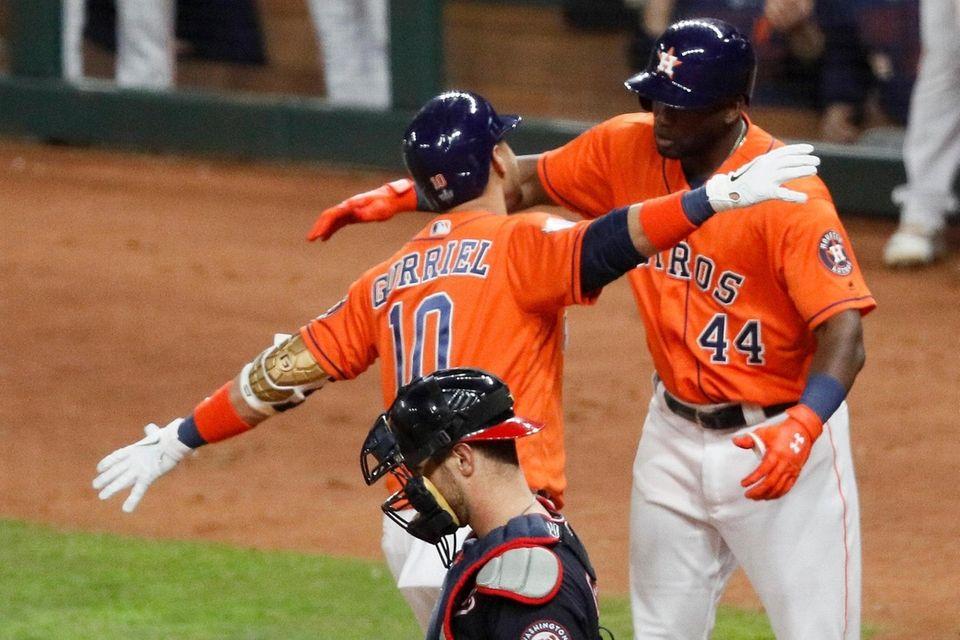 Houston Astros' Yuli Gurriel celebrates with Yordan Alvarez