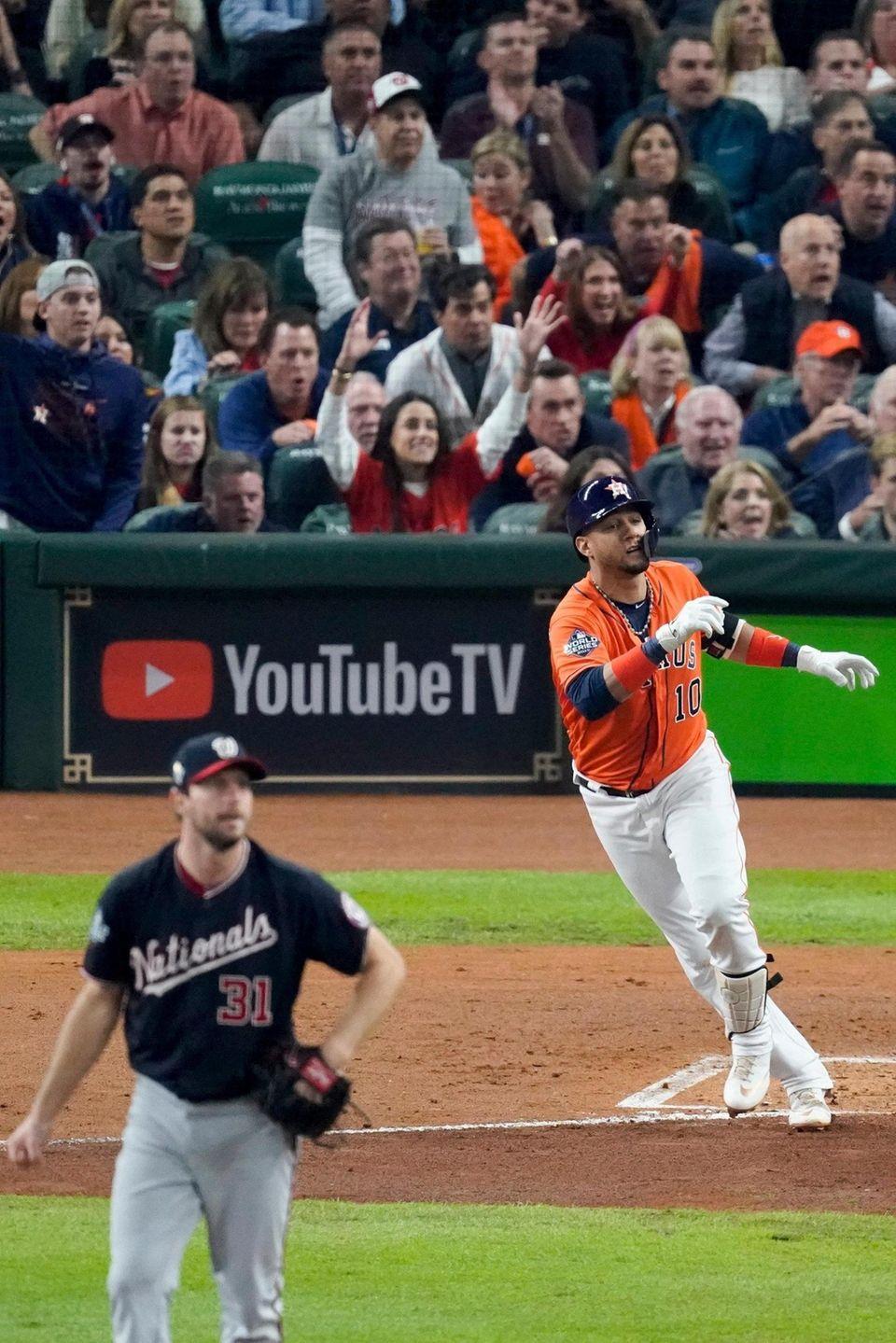 Houston Astros' Yuli Gurriel watches his home run
