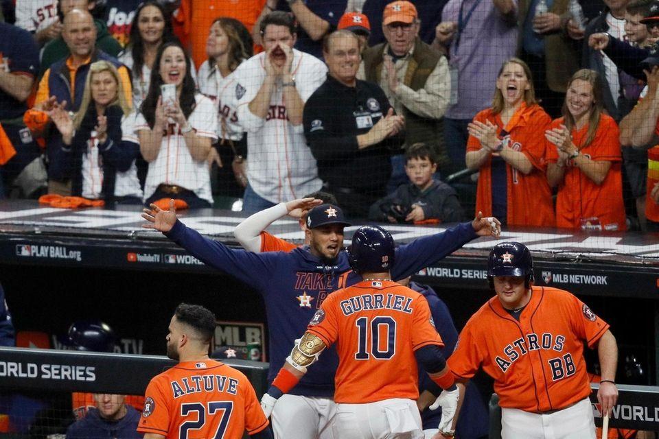 Houston Astros' Yuli Gurriel celebrates after his home