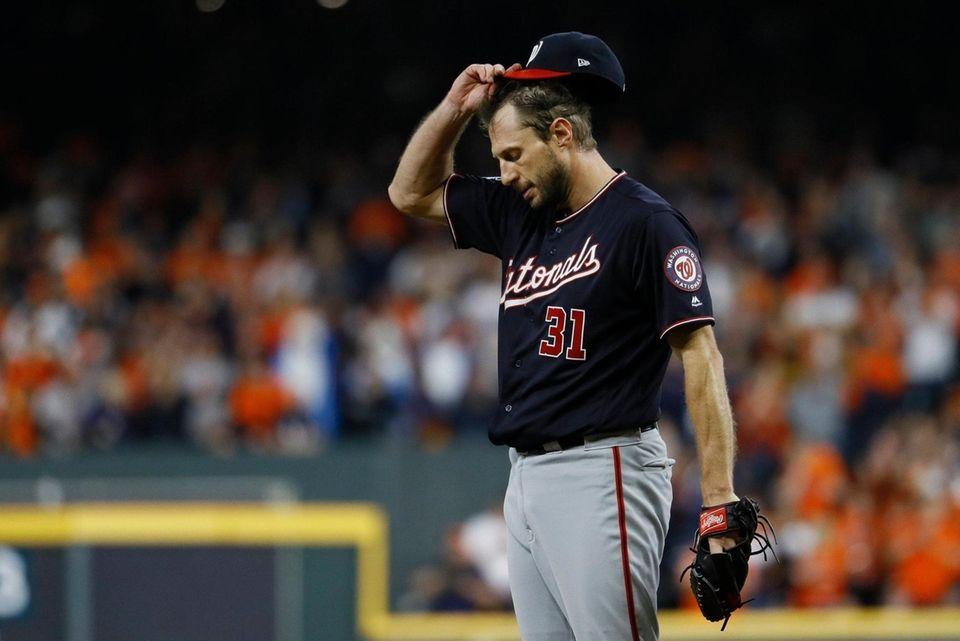 Washington Nationals starting pitcher Max Scherzer reacts after