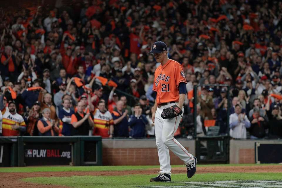 Fans cheer as Houston Astros starting pitcher Zack