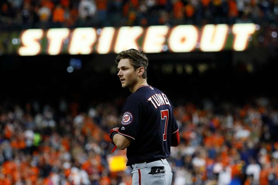 Washington Nationals' Trea Turner reacts after his strikeout