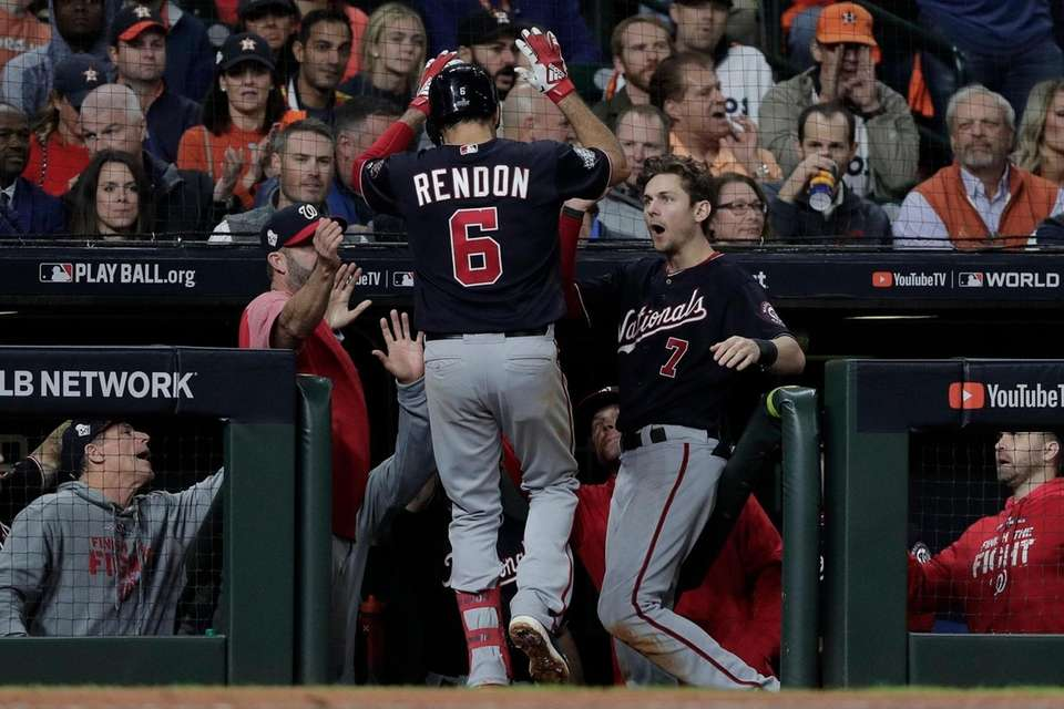 Washington Nationals' Anthony Rendon is congratulated after hitting
