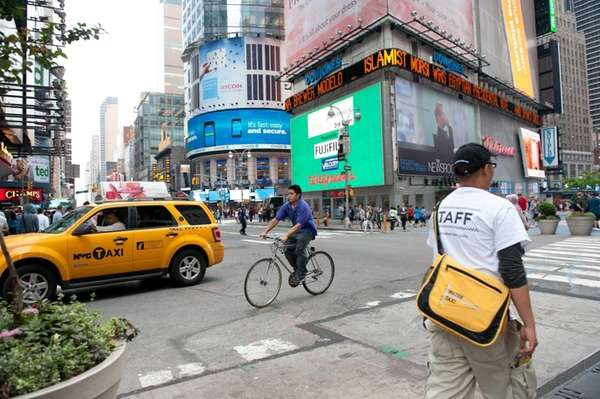A cyclist crosses 42nd street in Manhattan, sharing