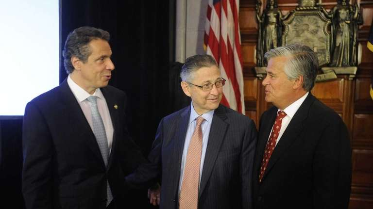 New York Gov. Andrew Cuomo, left, appears at