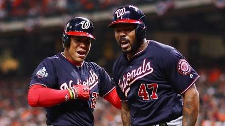 Howie Kendrick of the Nationals is congratulated by