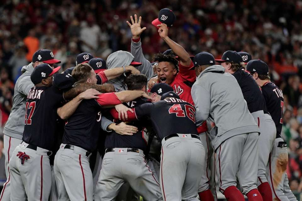 The Washington Nationals celebrate after Game 7 of