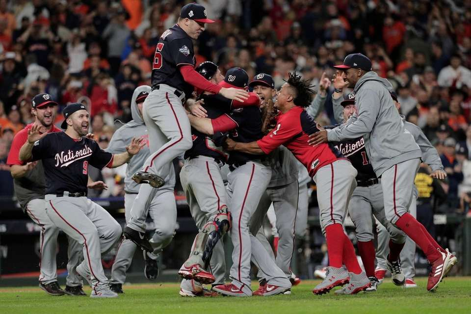The Nationals celebrate after Game 7 of the