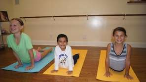 Children enjoying a yoga class at Om Sweet