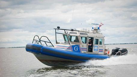 A Suffolk County Police marine unit sails on