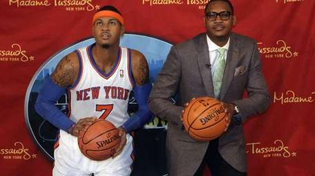 Carmelo Anthony, right, poses with a wax figure