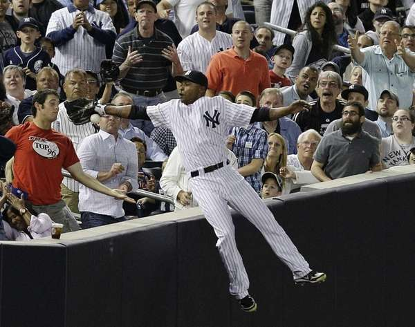 Fans watch as New York Yankees left fielder