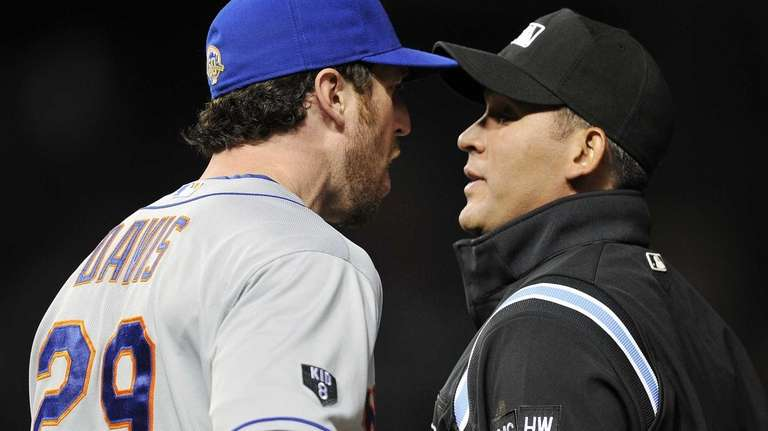 Ike Davis argues with first base umpire Manny