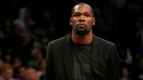 Kevin Durant of the Nets looks on during