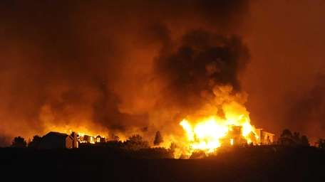 The Waldo Canyon fire destroys homes in the