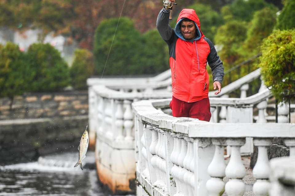 Despite the rain and mist, Darwin Lopez, 28,