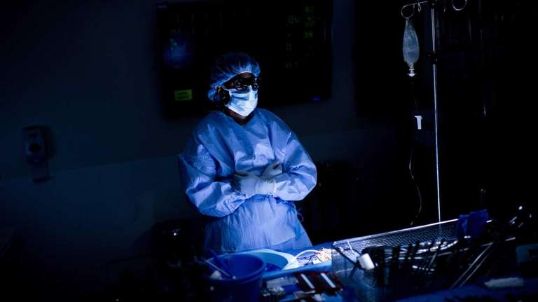 A doctor waits during surgery at Johns Hopkins