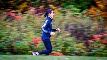 NIcole Henn of Syosset runs trails Wednesday to