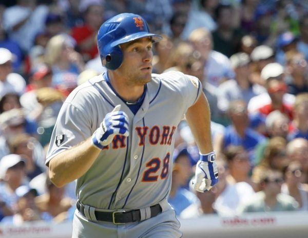 New York Mets' Daniel Murphy watches his two-run