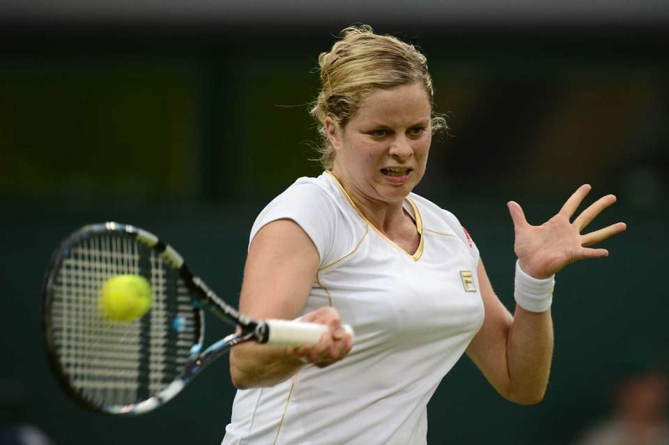 Belgium's Kim Clijsters plays a forehand shot during