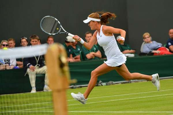 Poland's Agnieszka Radwanska chases the ball during her
