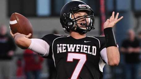 Newfield quarterback Maxwell Martin passes the football against
