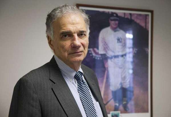Ralph Nader stands next to his poster of