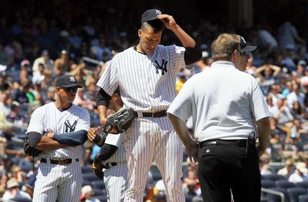 Andy Pettitte stands on the mound as he's