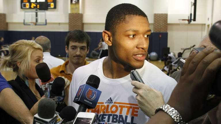 Bradley Beal answers questions from the media following