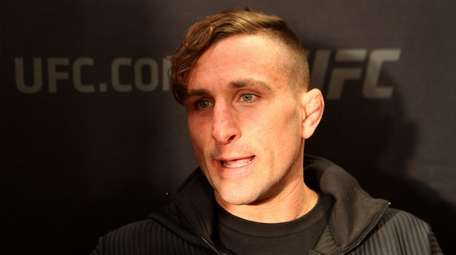 Gregor Gillespie, from Massapequa, answers questions during UFC