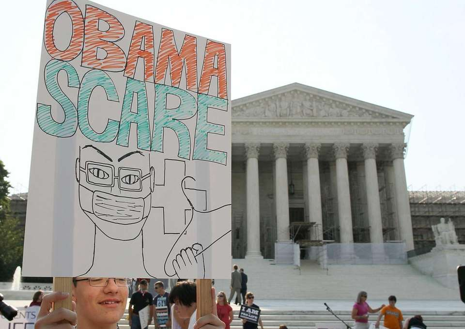 A man protests against the Obama administration's health