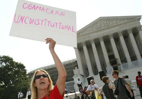 A woman protests against the Obama administrations health