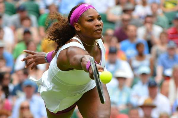Serena Williams plays a forehand shot during her