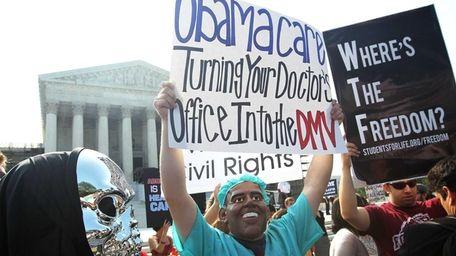 Anti-Obamacare protesters wear masks of U.S. President Barack