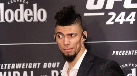 Johnny Walker looks on at UFC 244 media