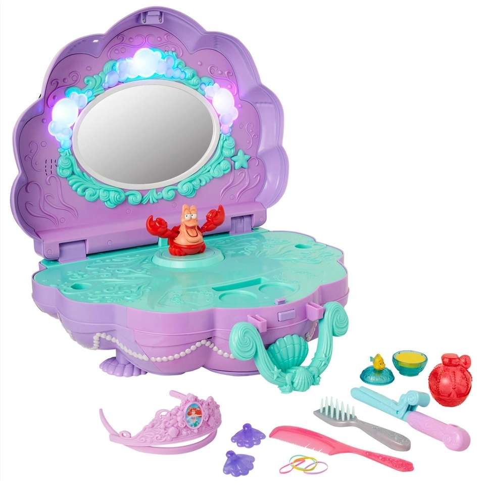 """Open the clamshell-shaped vanity to hear """"Under The"""