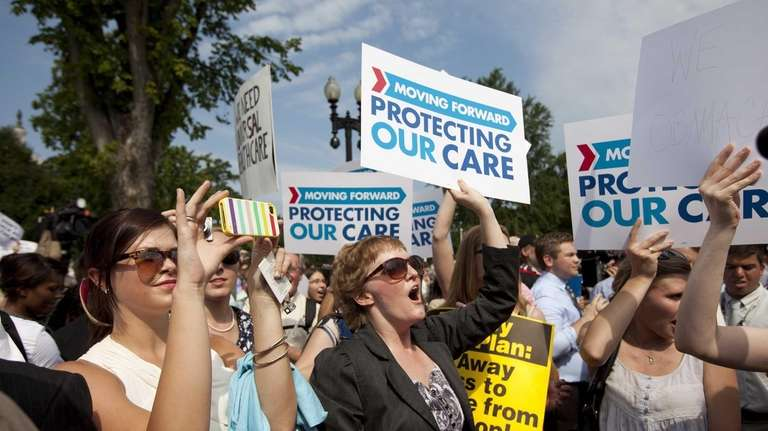 Demonstrators react to the Supreme Court landmark decision