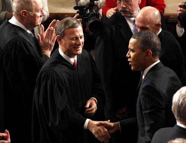 Supreme Court Chief Justice John Roberts greets President
