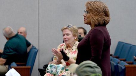 Lynda Perdomo-Ayala stands as the Suffolk County Legislature