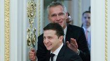 Ukrainian President Volodymyr Zelensky, foreground, and NATO Secretary-General