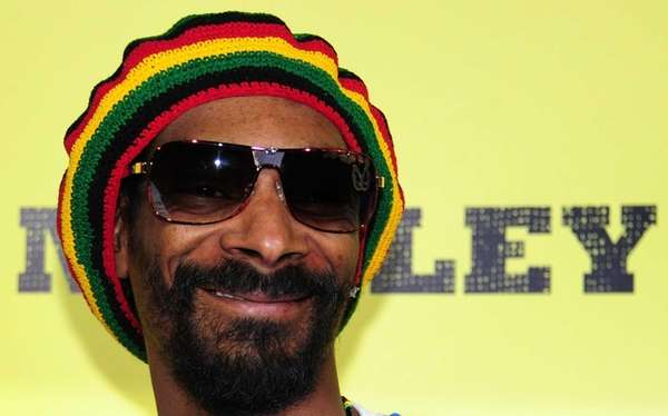 Snoop Dogg poses on arrival for the premiere