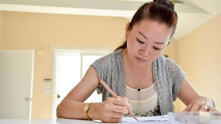 Vivian Chen of Amityville works on a new
