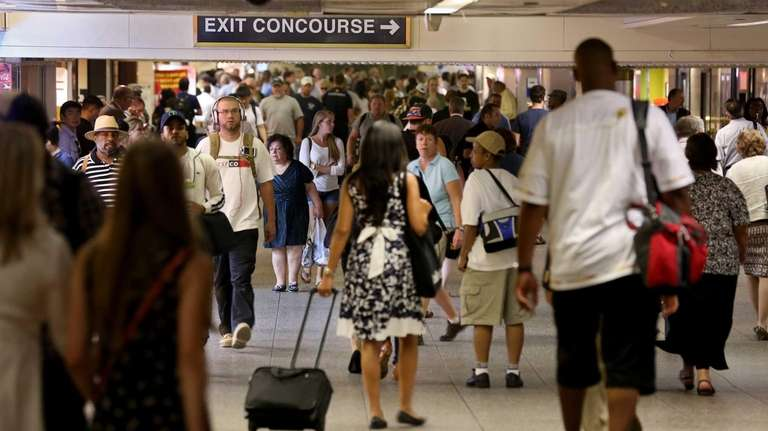 Commuters walk through the crowded terminal at Penn