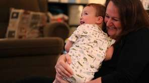Jill, with her youngest son, 20 months, at