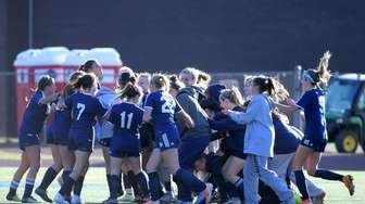 Smithtown West girls soccer team celebrates after beating