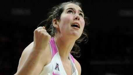 UConn's Natalie Butler reacts to her basket in