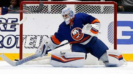 Thomas Greiss of the Islanders makes a save