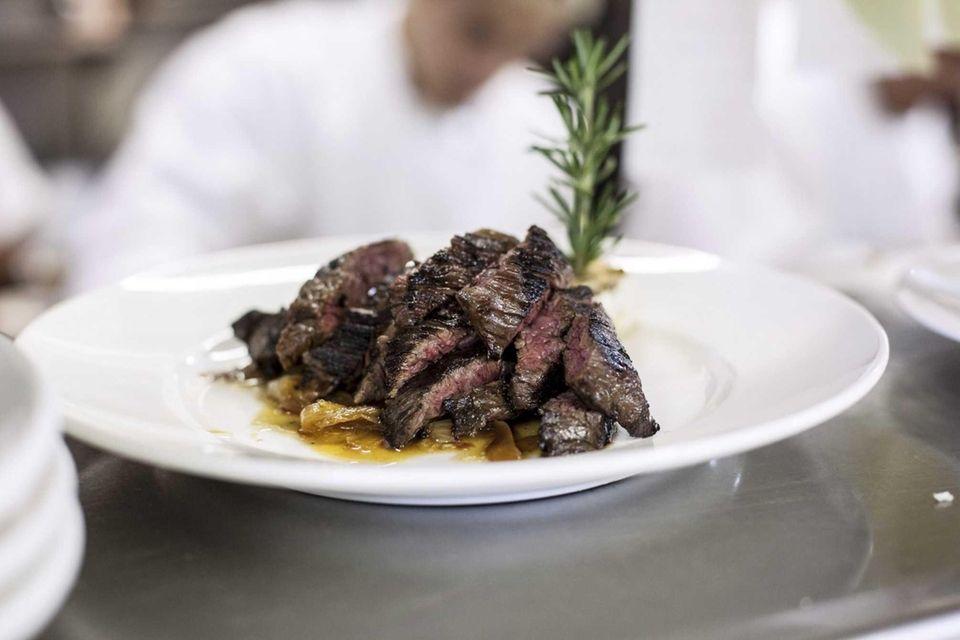 Marinated skirt steak, sliced to order and garnished