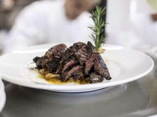 Marinated skirt steak, sliced to order and garnished