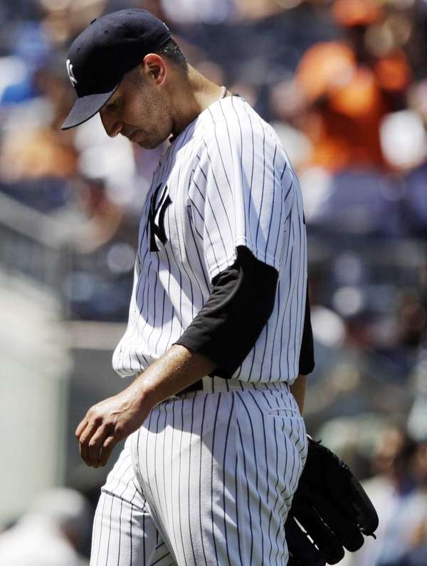 Andy Pettitte leaves the game during the fifth